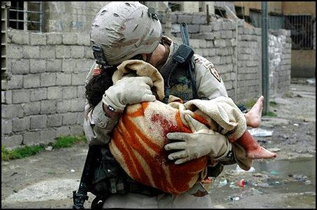 War Baby - An American Soldier holding an injured child